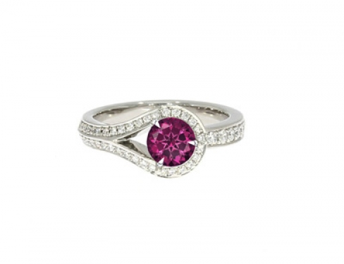 Drop Ring in platinum and Diamonds with pink Sapphire centre